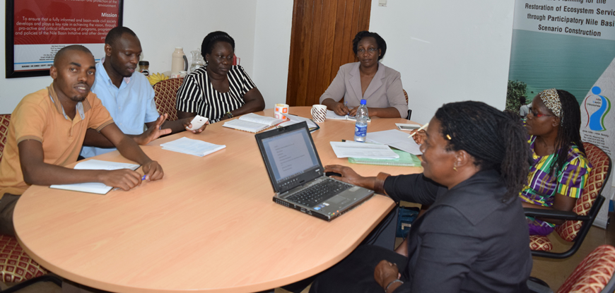 Part of Z-A Engineering Consulting team led by Ms. Elizabeth Kharono (right back) and the NBD Secretariat team led by Ms. Hellen Natu (right front), in discussions at the NBD Secretariat Office in Entebbe, Uganda. August 2016. Courtesy, NBD